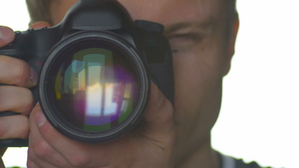 The photographer work with camera, close up view