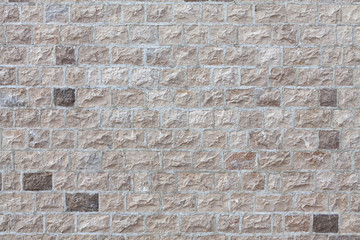 house wall faced with stone tiles