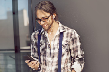 Happy man with mobile phone, sending text message