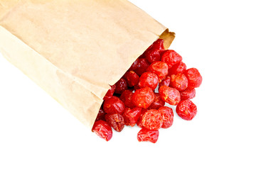 Candied cherry in paper bag