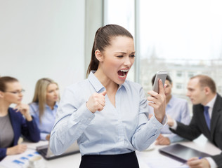 screaming businesswoman with smartphone