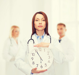 calm female doctor with wall clock