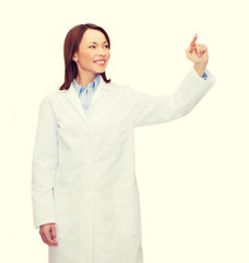 doctor pointing to something or pressing button