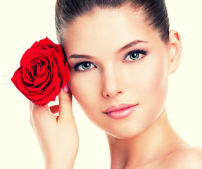 Beautiful woman with a red rose.