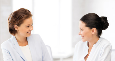 two businesswomen having discussion in office