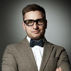Confident nerd in eyeglasses and bow tie