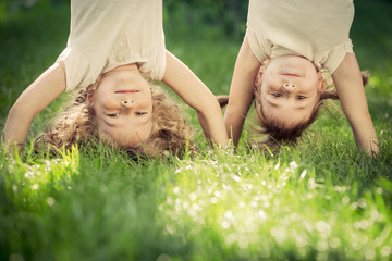 Happy children standing upside down