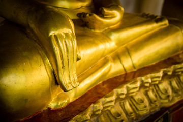 Hand of golden Buddha statue