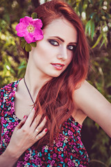 Beautiful girl with flower in her long hair