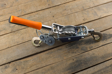 hand power puller tool on wood background