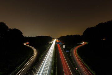 highway crossing with light trails
