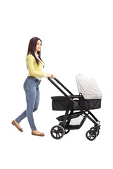 Young mother pushing a baby stroller