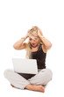Sad blonde woman sitting on the floor with notebook over white i