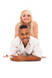 Smiling caucasian girl and black guy couple lying on the floor o