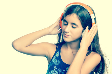 Instagram toned image of a teenage girl listening to music