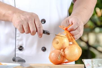 Chef peeling onions