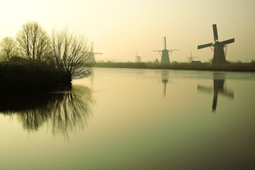 Traditional Dutch windmills at dawn in Kinderdijk, Netherlands