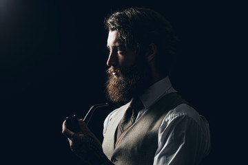 Silhouette Man with Beard Holding Smoking Pipe