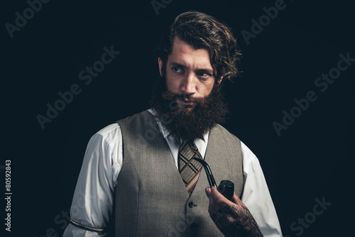 Man with Long Goatee Beard Holding Cigarette Pipe - 80592843