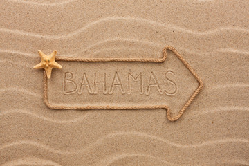 Arrow made of rope and starfish with the word Bahamas on the san