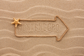 Arrow made of rope and sea shells with the word Montenegro on th