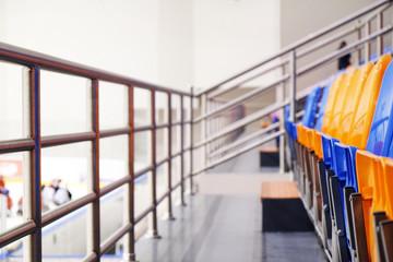 Ice Stadium - Empty blue and orange chairs