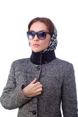 Fashion young woman is wearing sunglasses and coat. All isolated