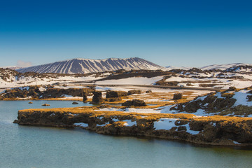 Valcano mount and lake in Myvatn Winter
