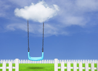 Children swing in the park with blue sky