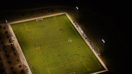 Aerial view of soccer football match at night