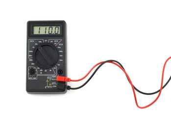 Digital multimeter with red and black wires shows 110 volts