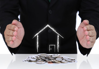 House insurance with businessman hand and coins