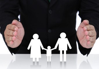 Businessman hand protect  family