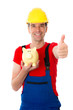 workman with thumb up is showing a piggy bank