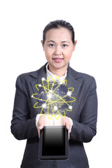 Business woman holding a tablet with planet Earth. Elements of t