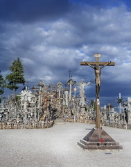 cross with golden Christ to the Hill of Crosses