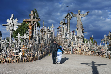 People pay tribute to the dead at the Hill of Crosses