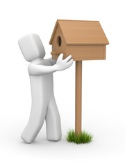 Man sets birdhouse