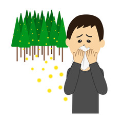 A young man blowing nose, allergy caused by cedar pollen