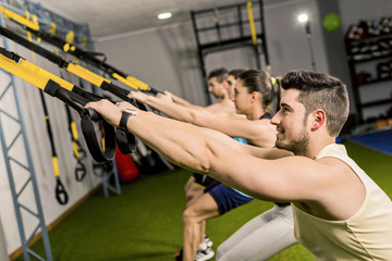 Elastic Rope exercises with trx rope at gym