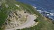 Aerial view of car following Californian coastline