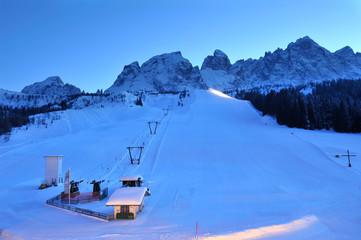Alpine ski slope by night