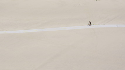 Aerial view of cyclist on beach