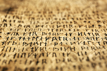 Grunge paper with hieroglyphics close up