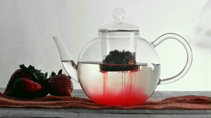 strawberry infusion tea with tea cup