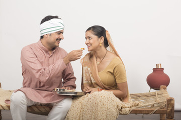 indian couple eating food