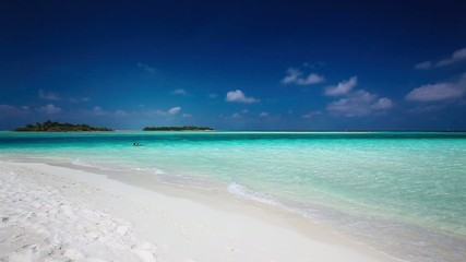 Romantic sandy beach with amazing clean lagoon in Maldives