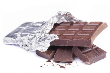 Dark chocolate bar on white background