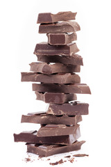 Stack of dark chocolate, isolated on white background