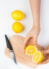Cutting Lemons on Wooden Cutting Board